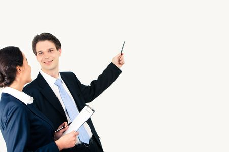 Photo of confident businessman raising his hand and showing something to woman photo