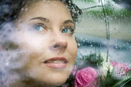 look through window: Photo of pretty face of bride through window of