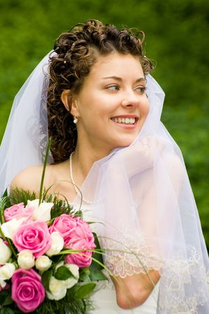 marriageable: Portrait of beautiful bride with smile  holding the bouquet