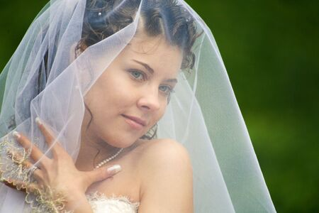 marriageable: Image of head of attractive woman under white veil Stock Photo