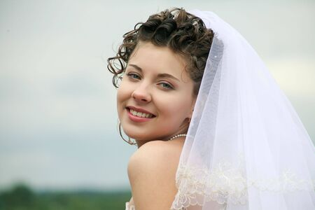 Portrait of happy bride looking at camera with smile  photo