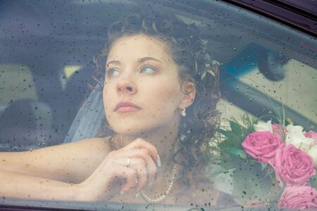 View of beautiful woman sitting in the  driving her to wedding   photo