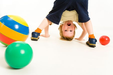 Portrait of boy looking at camera between his legs Stock Photo - 3177770