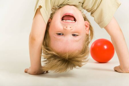 View of boy's head over heels on a white background Stock Photo - 3177798