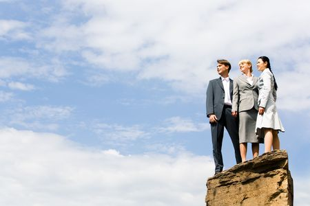 woman on top: Business group of people standing on the hill and looking aside Stock Photo