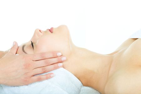 Beautiful woman is getting a facial massage in the spa salon Stock Photo - 3210283