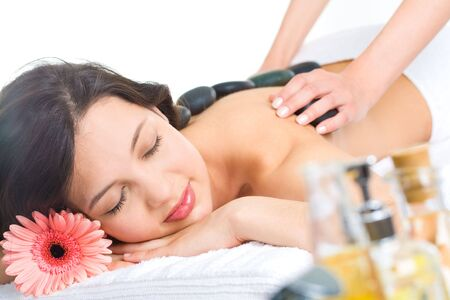 Photo of young naked woman getting a stone massage in a spa Stock Photo - 3210314