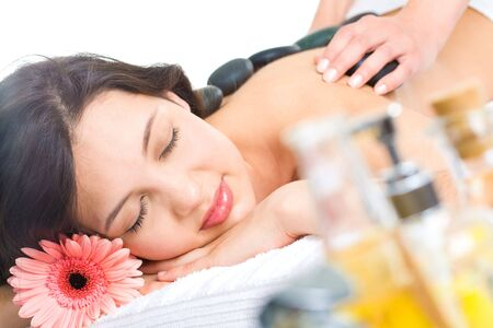 Pretty woman enjoys massage in the spa salon  Stock Photo - 3210319