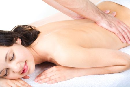 Portrait of smiling woman taking enjoyment from massage photo