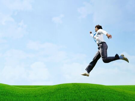 over the horizon: Photo of busy businessman  jumping over field
