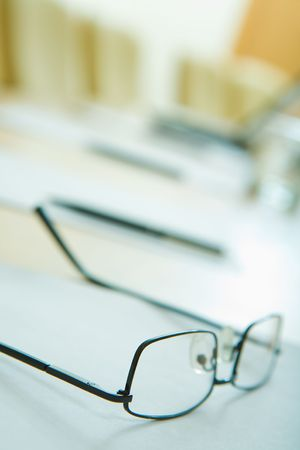 Close-up of glasses on the table on the background of business objects photo