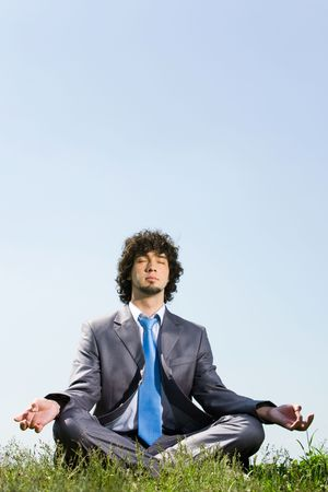 Image of businessman doing yoga in a natural environment  photo