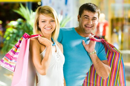 Portrait of happy man and woman with shopping bags in the mall Stock Photo - 3246311