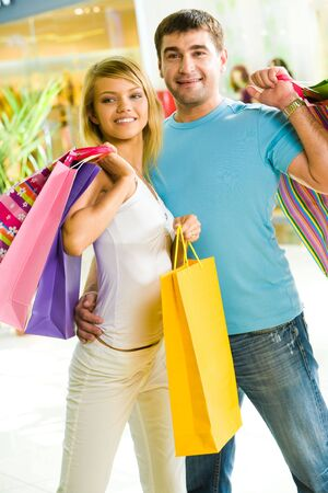 Portrait of loving couple in the shopping centre looking aside with happy smiles Stock Photo - 3246316