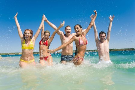 entertainment funny: Image of happy teens playing while their vacation Stock Photo