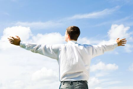 Image of businessman standing aback and looking at blue sky in summer Stock Photo - 3275698