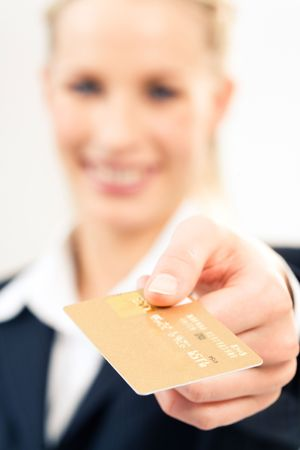 Close-up of plastic credit card in businesswoman's hand  photo