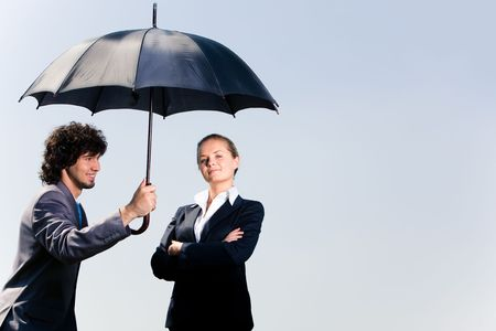 umbrella rain: Image of confident business man holding umbrella and looking at woman on the background of sky