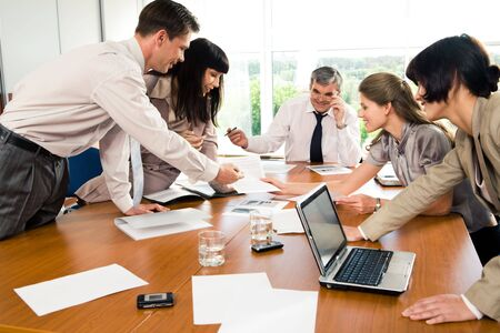 Professionals gathered together and discussing ideas at seminar   Stock Photo - 3275744