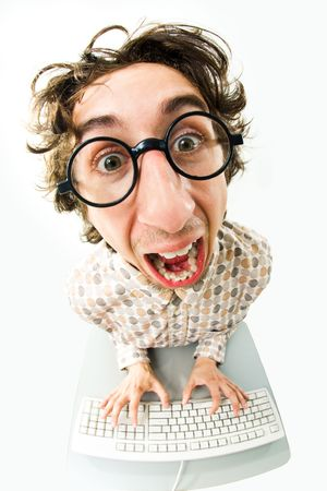 Portrait of funny man screaming during typing a document  Stock Photo