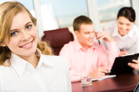Portrait of blonde woman looking at camera in working environment in office Stock Photo - 3305522