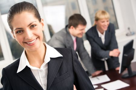 workers group: Portrait of smart manager in working environment at meeting in the office