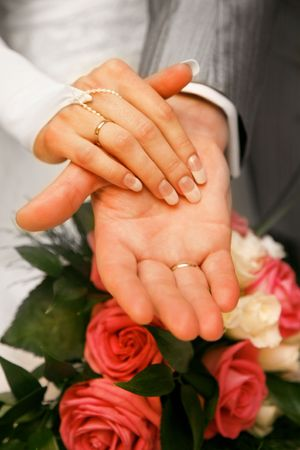 Photo of hands of newly-married over bunch of flowers Stock Photo - 3291099