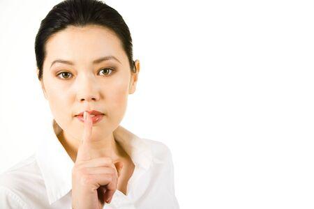 Portrait of businesswoman in white shirt pronouncing shhhh Stock Photo - 3291857