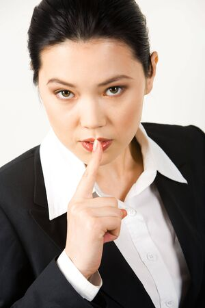 hushed: Portrait of responsible secretary showing sign - shhhh  Stock Photo