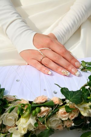 marriageable: Photo of beautiful hands of bride over bunch of flowers