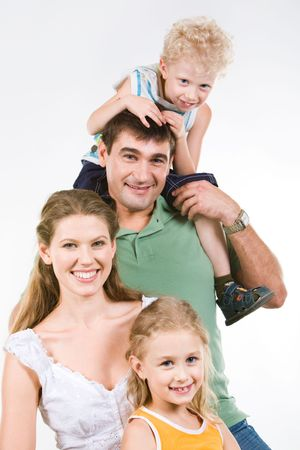 Portrait of boy sitting on neck of father with mother and sister near by  Stock Photo - 3293578