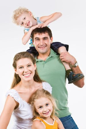 family photo: Portrait of four happy people looking at camera in the studio  Stock Photo