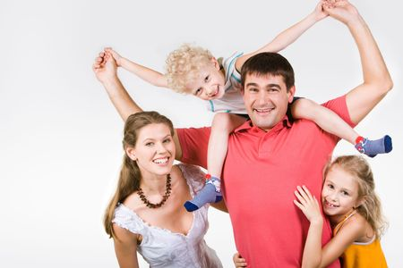 Image of woman and girl embracing man holding son on his neck Stock Photo - 3293572