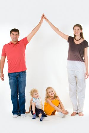 Image of husband and wife touching their hands over children Stock Photo - 3293565