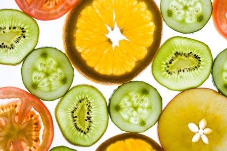 Slices of fruits and vegetables: kiwi, orange, apple, tomato, cucumber   photo