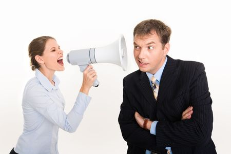 Image of businesswoman screaming by megaphone and businessman listening to her voice   photo