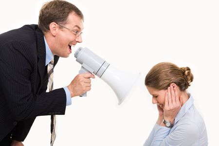Image of angry boss screaming by megaphone on his secretary  photo