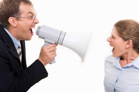 Businessman shouting by megaphone opposite screaming woman  photo
