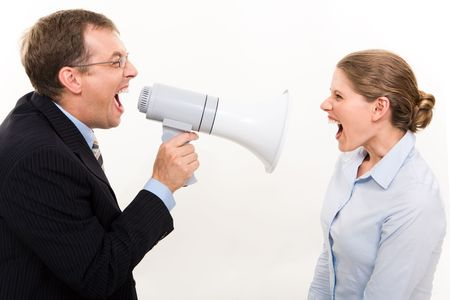 Portrait of confident chief shouting through megaphone on the angry woman  photo
