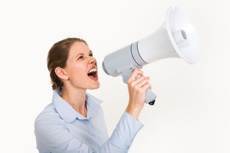 agitation: Portrait of businesswoman holding megaphone shouting something on a white background