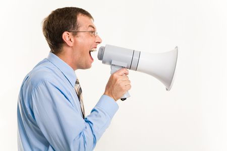 Profile of man shouting through megaphone isolated over white background photo