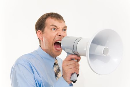 Photo of businessman with megaphone in hand screaming into it photo