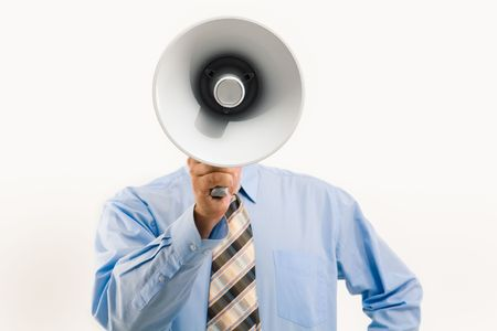 loudness: Image of man standing in front of camera and speaking into megaphone