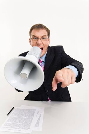 Photo of businessman sitting at the table speaking through megaphone and pointing at camera Stock Photo - 3315850