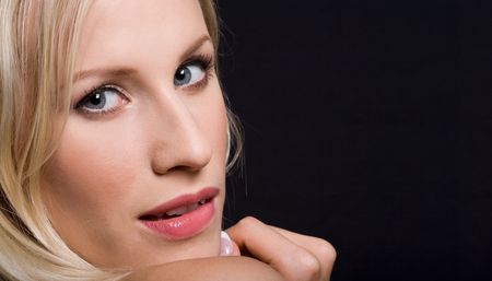 Close-up of blonde woman with seductive expression on her face looking at camera Stock Photo - 3318638