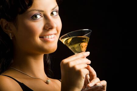 Portrait of charming woman holding cocktail with champagne photo