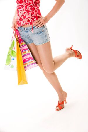 Image of woman's legs  isolated on a white background  photo