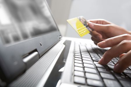 Image of hands holding credit card and pressing a keys of  keyboard Stock Photo