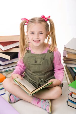 Image of happy pretty girl sitting and holding book Stock Photo - 3382769