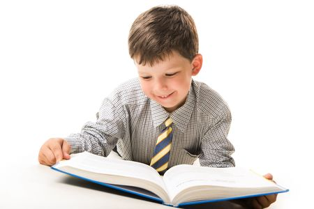 Photo of smart pupil lying and reading textbook over white background photo
